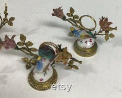 Ensemble de cinq porte-places en porcelaine et en métal 2 x 3